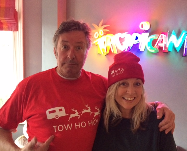 Roland and Monica Rivron wearing an Official Tow Ho Ho T Shirt